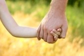 father holding childs hand